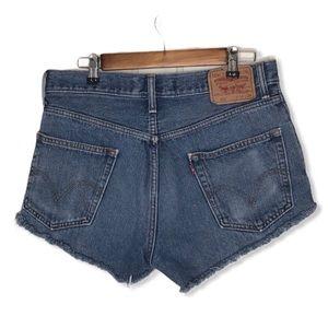 Levi's 550 High Rise Cut Off Denim Shorts.